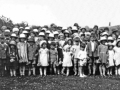 96  Children with mugs. Possibly Coronation 1937 or Jubilee 1935
